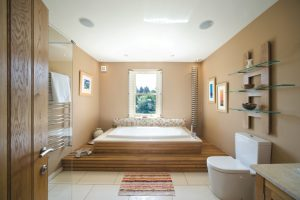 Wood Bathroom  with sunken bath and spiral radiator